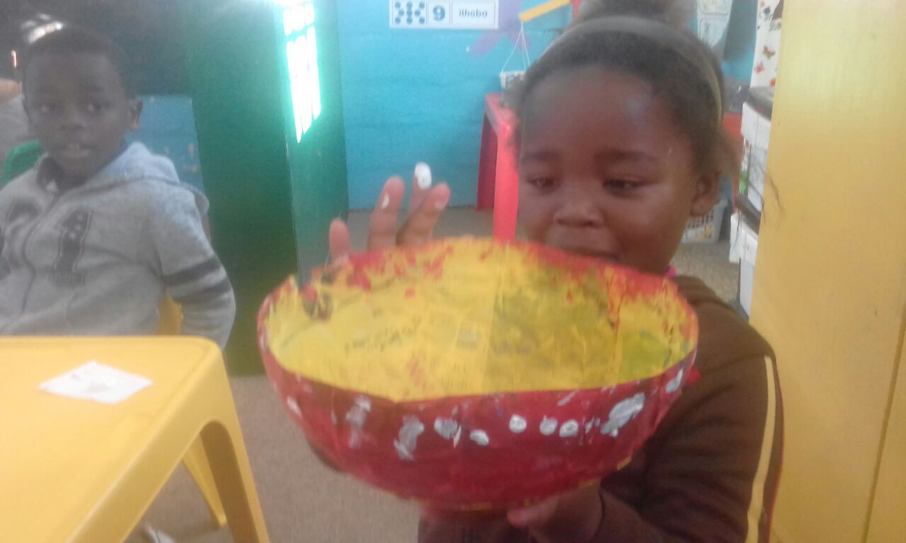Working with paper mache at Funimfundo Pre-school